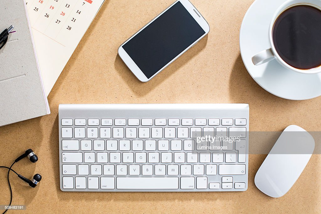 Wireless keyboard, mouse and cell phone on table : Stock Photo