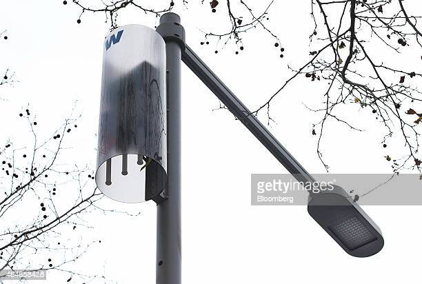A wireless LED streetlight as known as a 'smart' light right with an IP address to improve energy efficiency stands on a street in Barcelona Spain on...