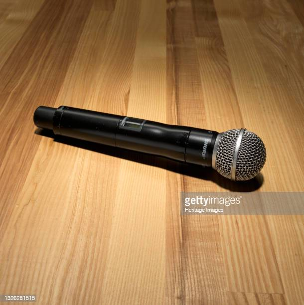 Wireless microphone used by Rakim to record the album 'The 18th Letter' . The hand-held microphone has a circular silver mesh wire grill covering the...