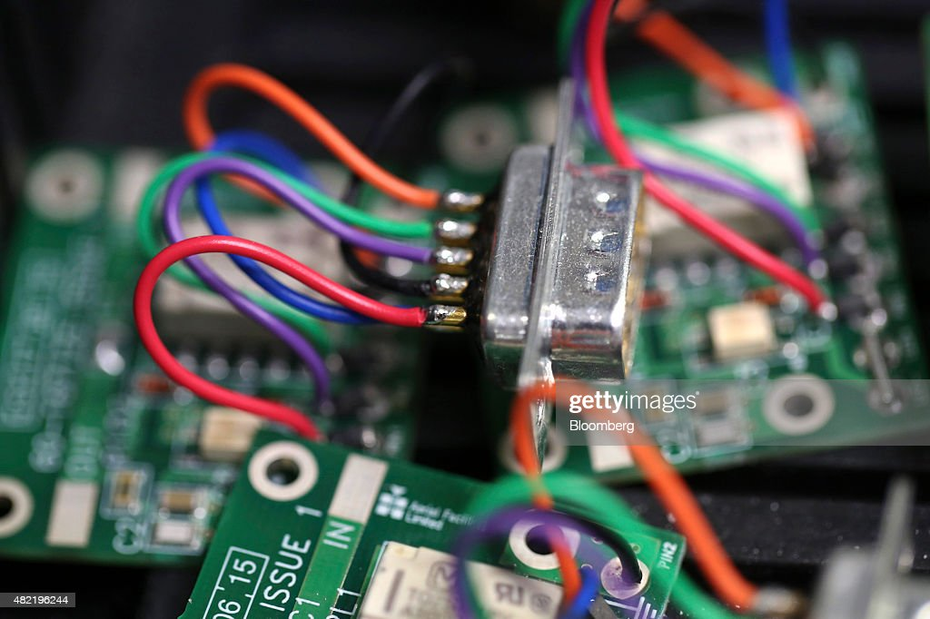 Wires attach a component to a printed circuit board at Texcel Technology Plc's factory in Dartford, U.K., on Tuesday, July, 28, 2015. U.K. economic growth accelerated in the second quarter as business services and finance strengthened and North Sea output surged. Photographer: Chris Ratcliffe/Bloomberg via Getty Images