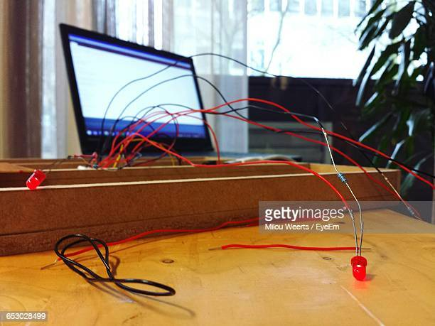 Wires On Wooden Table By Laptop At Home