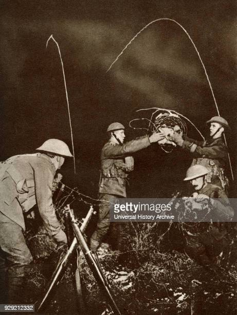 A wiring party Soldiers erecting barbed wire entanglements in No Man's Land under cover of darkness during World War One From The Story of 25...