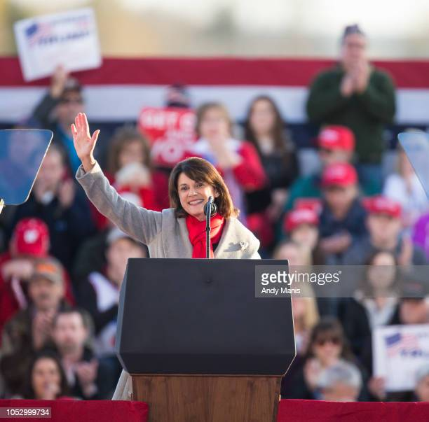 Wis Sen Leah Vukmir talks to the crowd before US President Donald Trump makes an appearance at a rally on October 24 2018 in Mosinee Wisconsin The...