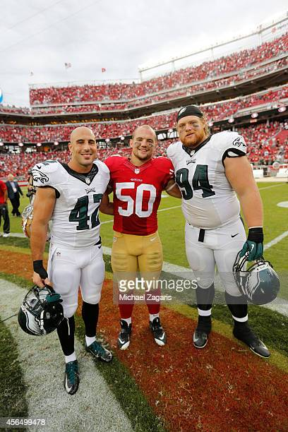 Wisconsin alums Chris Borland of the San Francisco 49ers stands on the field with Chris Maragos and Beau Allen of the Philadelphia Eagles stand on...
