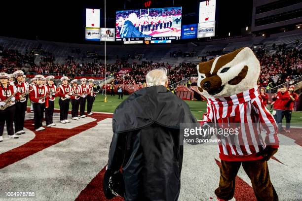 Wisconsin Badger Band Director Michael Leckrone walks off the field and shakes hands with Bucky Badger for the final time after the 5th quarter after...