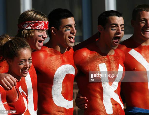 wisconsin badger football fans - football body paint stock photos and pictures