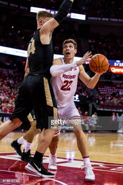 Wisconsin Badger forward Ethan Happ looks to go up for a shot over Purdue Boilermakers center Isaac Haas during an college basketball game between...