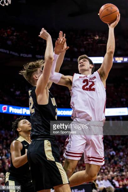 Wisconsin Badger forward Ethan Happ takes a hook shot over Purdue Boilermakers forward Matt Haarms during an college basketball game between Purdue...