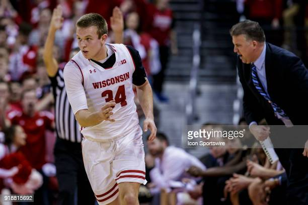Wisconsin Badger guard Brad Davison celebrates after making a 3 pointer during an college basketball game between Purdue Boilermakers and the...