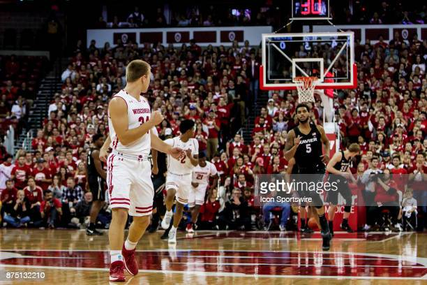 Wisconsin Badger guard Brad Davison fist pumps after a 2 made free throws by Wisconsin Badger forward Ethan Happ durning an college basketball game...