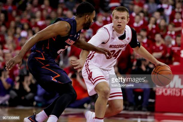 Wisconsin Badger guard Brad Davison looks to run the offense and create space during an college basketball game between Illinois Fighting Illini and...