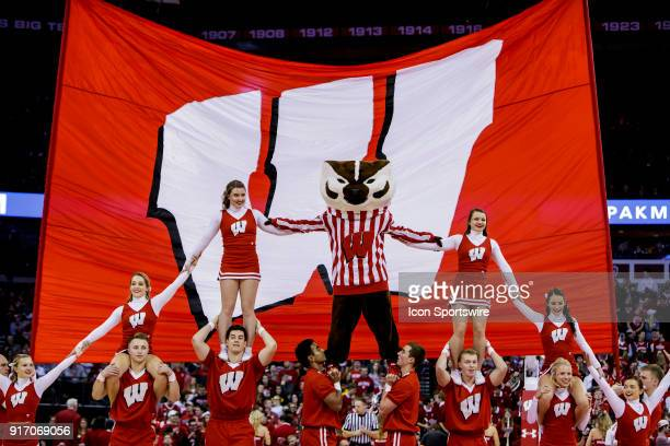 Wisconsin Badger mascot Bucky Badger and the Wisconsin Badger cheerleaders perform during a media timeout during an college basketball game between...