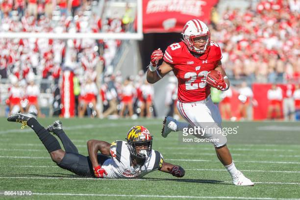 Wisconsin Badger running back Jonathan Taylor eludes a tackle by Maryland Terrapin defensive back Darnell Savage Jr during a Big Ten football game...