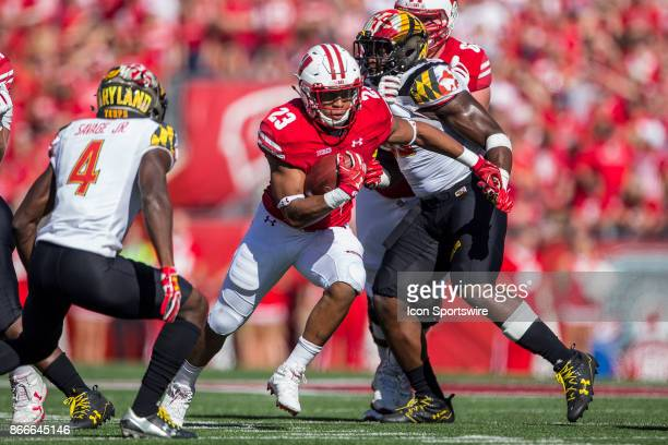 Wisconsin Badger running back Jonathan Taylor makes a cut to the open field on Maryland Terrapins defensive back Darnell Savage Jr durning an college...