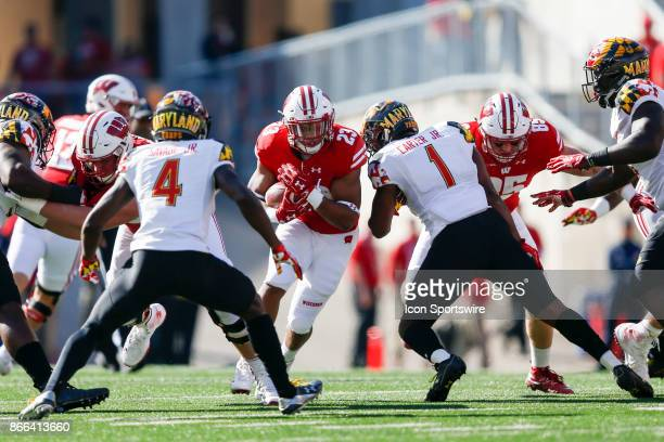 Wisconsin Badger running back Jonathan Taylor tries to get through Maryland Terrapin defensive back Darnell Savage Jr and Maryland Terrapin...