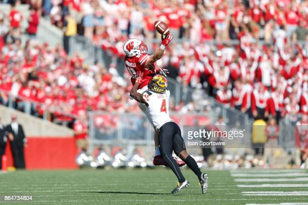 Wisconsin Badger tight end Troy Fumagalli can't hang onto the pass as Maryland Terrapin defensive back Darnell Savage Jr defends during a Big Ten...