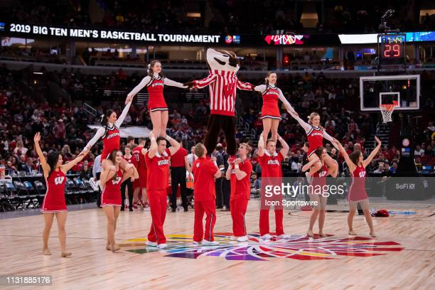 Wisconsin Badgers cheerleaders perform a pyramid during a Big Ten Tournament quarterfinal game between the Nebraska Cornhuskers and the Wisconsin...