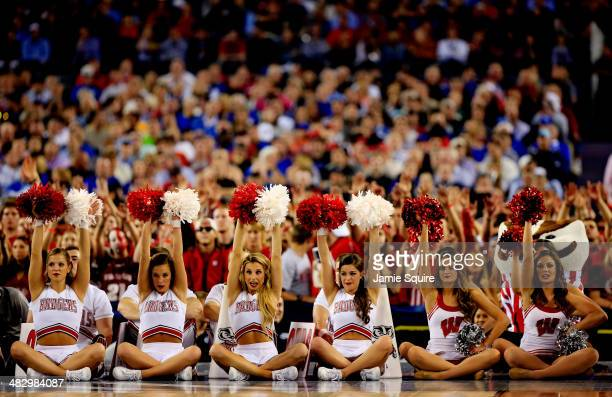 Wisconsin Badgers cheerleaders perform during the NCAA Men's Final Four Semifinal against the Kentucky Wildcats at ATT Stadium on April 5 2014 in...