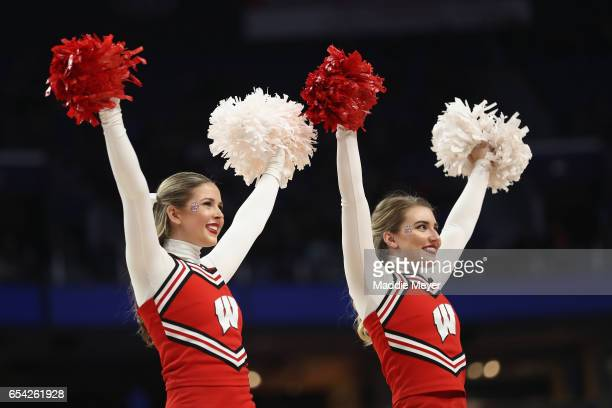 Wisconsin Badgers cheerleaders perform in the first half against the Virginia Tech Hokies during the first round of the 2017 NCAA Men's Basketball...