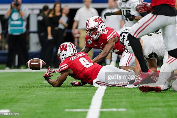 Wisconsin Badgers cornerback Sojourn Shelton and cornerback Natrell Jamerson chase after a fumble during the 81st Goodyear Cotton Bowl Classic game...