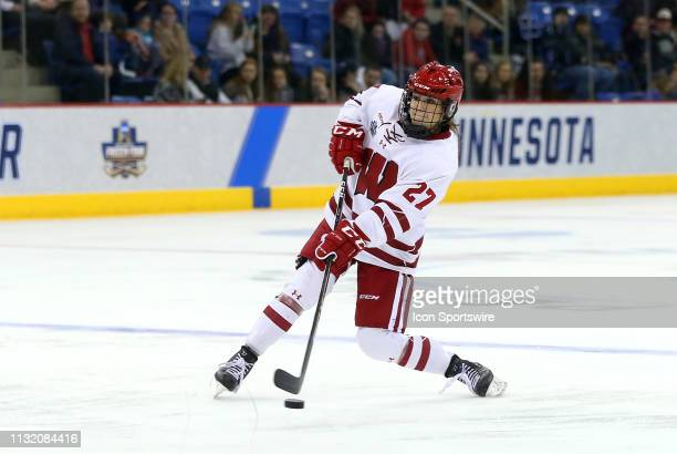 Wisconsin Badgers defenseman Grace Bowlby shoots the puck during the NCAA women's hockey game between Clarkson Golden Knights and Wisconsin Badgers...