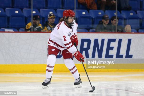 Wisconsin Badgers defenseman Natalie Buchbinder skates with the puck during the NCAA women's hockey game between Clarkson Golden Knights and...