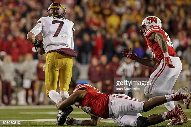 Wisconsin Badgers defensive end Chikwe Obasih gets the shoe string sack on Minnesota Golden Gophers quarterback Mitch Leidner durning an NCAA...