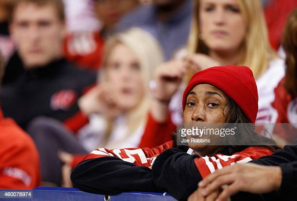 Wisconsin Badgers fan watches the final minutes of the Big Ten Championship against the Ohio State Buckeyes at Lucas Oil Stadium on December 6 2014...