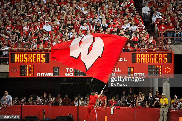 Wisconsin Badgers flag corp member waves their flag after the football team scores against the Nebraska Cornhuskers during their game at Memorial...