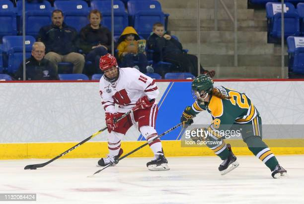 Wisconsin Badgers forward Abby Roque and Clarkson Golden Knights defenseman Josiane Pozzebon in action during the NCAA women's hockey game between...