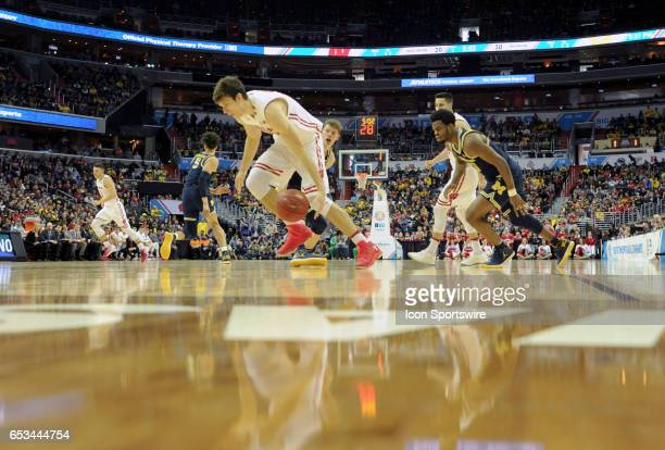 Wisconsin Badgers forward Ethan Happ drives to the basket against Michigan Wolverines forward Moritz Wagner in the Big 10 Tournament Championship...
