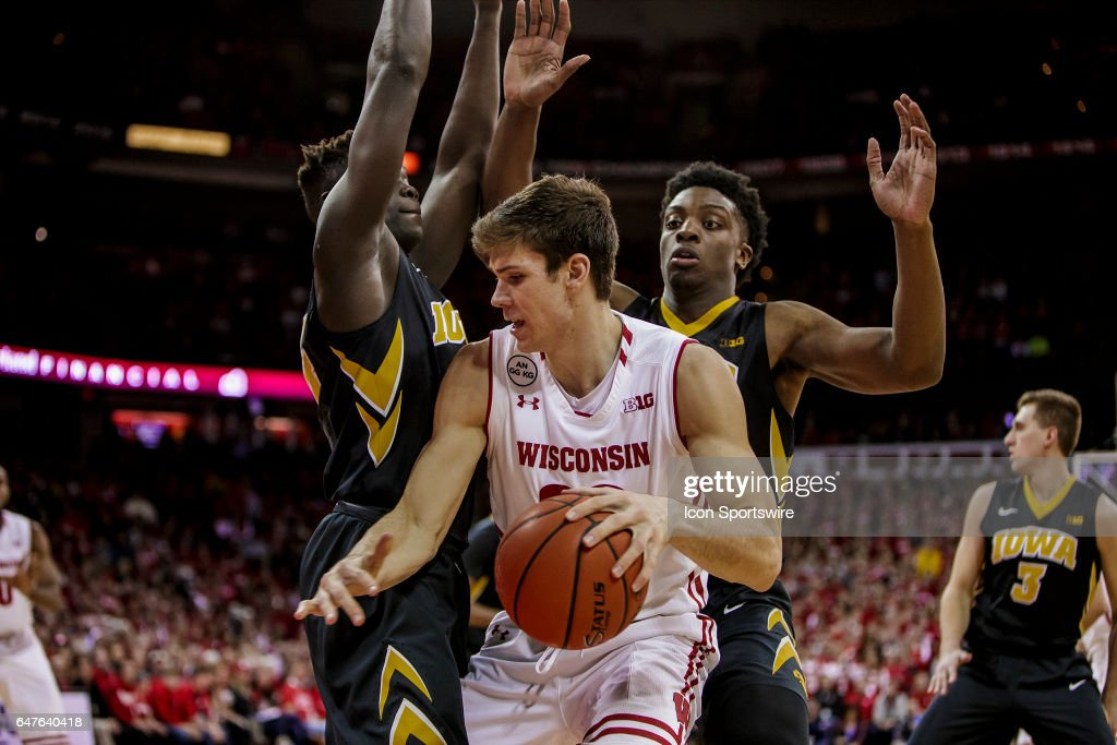 Wisconsin Badgers forward Ethan Happ (22) looks to dribble out of the double team during an college basketball game between the Iowa Hawkeyes and the Wisconsin Badgers at the Kohl Center in Madison, WI on March 02, 2017. The Iowa Hawkeyes defeat the Iowa Hawkeyes in a thriller 59-57.