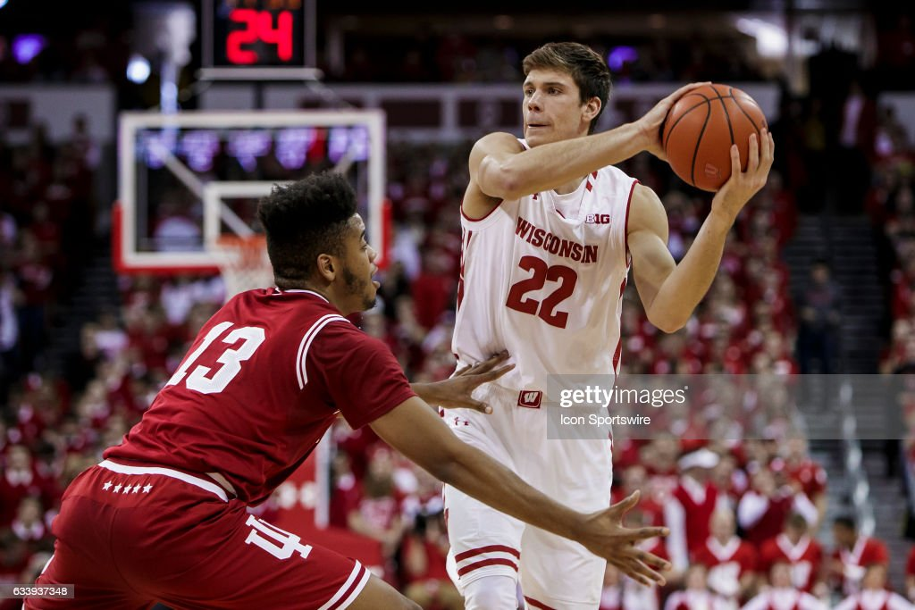 Wisconsin Badgers forward Ethan Happ (22) looks to pass the ball over Indiana Hoosiers forward Juwan Morgan (13) during an college basketball game between the Penn Indiana Hoosiers and the Wisconsin Badgers at the Kohl Center in Madison, WI on February 5th, 2017. Wisconsin defeats Indiana 65-60.