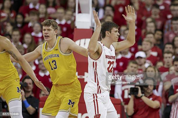 Wisconsin Badgers forward Ethan Happ reacts to a no call with Michigan Wolverines forward Moritz Wagner during an NCAA Basketball game between the...