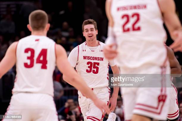 Wisconsin Badgers forward Nate Reuvers celebrates during a Big Ten Tournament quarterfinal game between the Nebraska Cornhuskers and the Wisconsin...