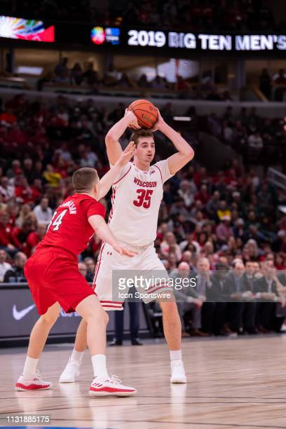 Wisconsin Badgers forward Nate Reuvers control's the ball during a Big Ten Tournament quarterfinal game between the Nebraska Cornhuskers and the...