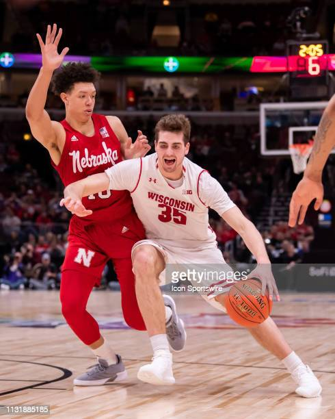 Wisconsin Badgers forward Nate Reuvers controls the ball during a Big Ten Tournament quarterfinal game between the Nebraska Cornhuskers and the...