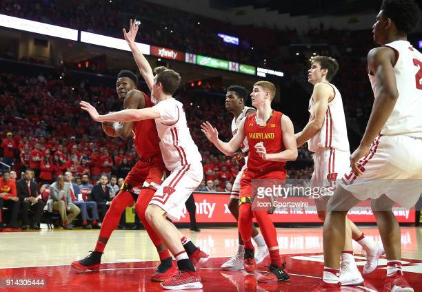 Wisconsin Badgers forward Nate Reuvers defends against Maryland Terrapins forward Bruno Fernando during a Big 10 men's basketball game between the...