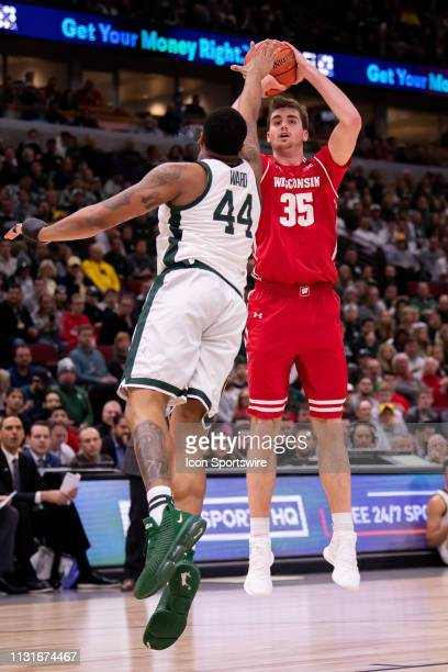 Wisconsin Badgers forward Nate Reuvers goes up for a shot against Michigan State Spartans forward Nick Ward during a Big Ten Tournament semifinal...