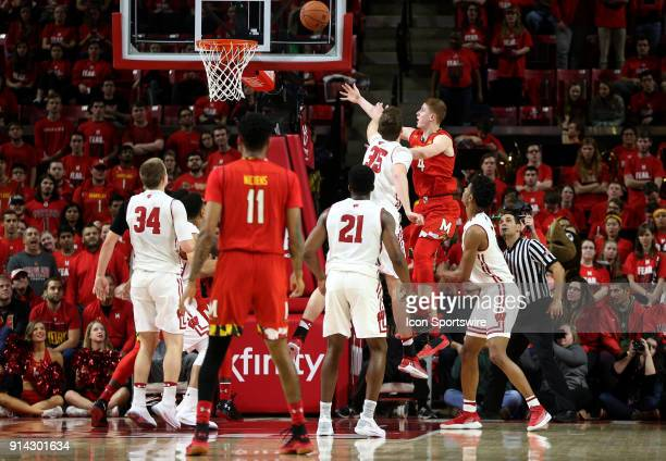 Wisconsin Badgers forward Nate Reuvers is too late to stop a shot by Maryland Terrapins guard Kevin Huerter during a Big 10 men's basketball game...