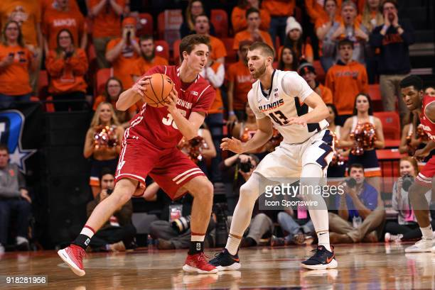 Wisconsin Badgers forward Nate Reuvers keeps the ball away from Illinois Fighting Illini forward Michael Finke during the Big Ten Conference college...