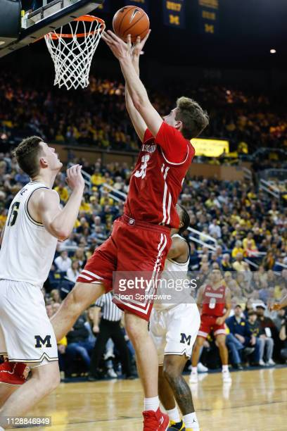 Wisconsin Badgers forward Nate Reuvers puts back a rebound during a regular season Big 10 Conference game between the Wisconsin Badgers and the...
