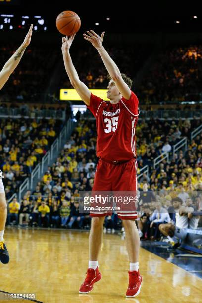 Wisconsin Badgers forward Nate Reuvers shoots a jump shot during a regular season Big 10 Conference game between the Wisconsin Badgers and the...