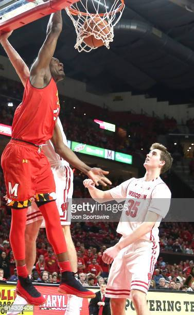 Wisconsin Badgers forward Nate Reuvers watches Maryland Terrapins forward Bruno Fernando go up for a score during a Big 10 men's basketball game...