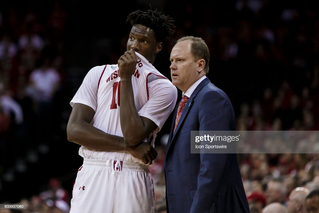 Wisconsin Badgers forward Nigel Hayes (10) talks with Wisconsin Badgers head coach Greg Gard during a free throw attempt during an college basketball game between the Penn Indiana Hoosiers and the Wisconsin Badgers at the Kohl Center in Madison, WI on February 5th, 2017. Wisconsin defeats Indiana 65-60.