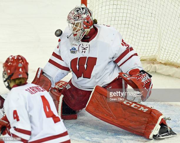 Wisconsin Badgers goalie Kristen Campbell keeps her eye on the puck off a Minnesota Golden Gophers shot during the Division I Women's Ice Hockey...
