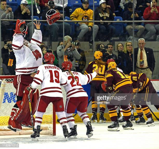 Wisconsin Badgers goalie Kristen Campbell leaps in celebration with teammates Annie Pankowski and Mekenzie Steffen as the buzzer sounds on the...