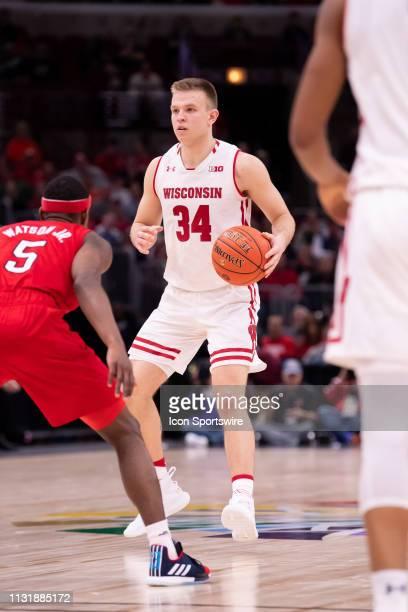 Wisconsin Badgers guard Brad Davison controls the ball during a Big Ten Tournament quarterfinal game between the Nebraska Cornhuskers and the...