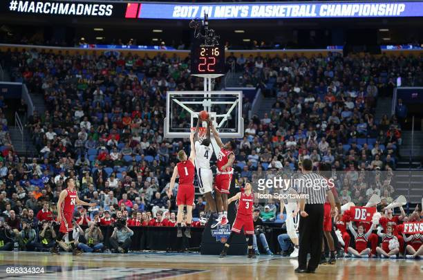 Wisconsin Badgers guard Khalil Iverson fouls Villanova Wildcats forward Eric Paschall during the NCAA Division 1 Men's Basketball Championship game...