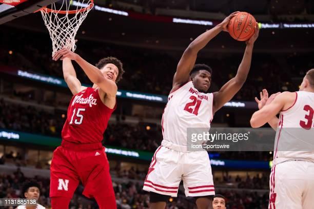 Wisconsin Badgers guard Khalil Iverson grabs the rebound against Nebraska Cornhuskers forward Isaiah Roby during a Big Ten Tournament quarterfinal...